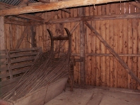 Inside old barn is an old thing for timber and crops